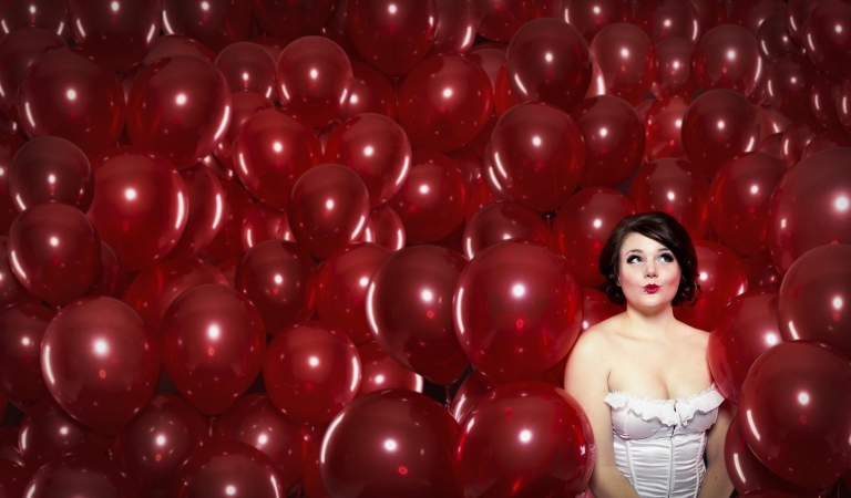10. Surrounded By Balloons